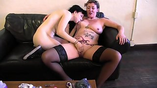 Old lady and a young bull dyke lube forth and fuck toys