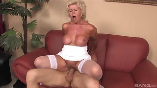 Mature granny Effie gives a titjob coupled with rides her younger lover